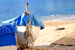 Fishing boat at the beach Stock Images