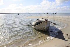 Fishing boat on beach. Beached fishing boat on sandy beach Stock Image