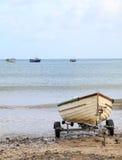 Fishing boat on beach stock photo