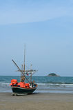 Fishing boat on a beach Stock Images