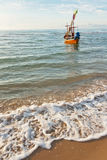 Fishing boat at the beach Stock Photography