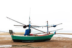 Fishing boat at beach Stock Photo