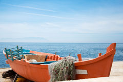 Fishing boat on the beach in Alexandroupolis, Greece. Copy space Royalty Free Stock Photo