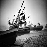 Fishing boat on the beach. Artistic look in black and white. Royalty Free Stock Image