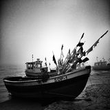 Fishing boat on the beach. Artistic look in black and white. Royalty Free Stock Photo