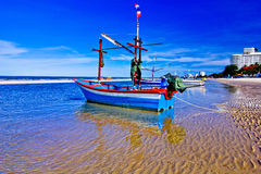 Fishing boat. A beach is beautiful, the green sea, the sky is blue, the fishing boat Stock Image