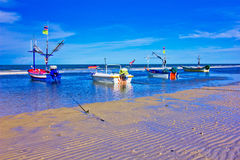 Fishing boat. A beach is beautiful, the green sea, the sky is blue Stock Photos