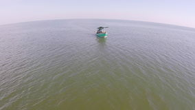 Fishing boat on the beach. Beautiful shot of aerial view. The Boat at the sea with many photographer. Two fishing boat on the beach. Beautiful shot of aerial stock footage