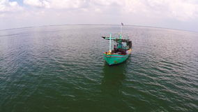 Fishing boat on the beach. Beautiful shot of aerial view. The Boat at the sea with many photographer. Two fishing boat on the beach. Beautiful shot of aerial stock video
