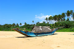 Fishing boat on the beach of Bentota Royalty Free Stock Image