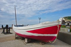 Fishing boat on the beach of Etretat in Normandy royalty free stock image