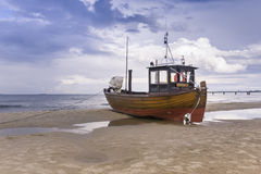 Fishing boat on beach stock images