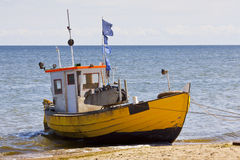 Fishing boat on the beach. Stock Photos