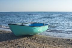 Fishing boat on the beach . Boat with oars stock photos