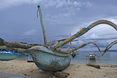 Fishing boat on the beach of Padangbai in Bali - Indonesia Stock Photo
