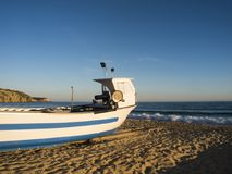 Fishingboat on the beach. Fishing boat on a beach in Portugal- beautiful area of Algarve Stock Photo