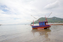 Fishing boat on the beach after sea tide Stock Photography