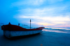 Fishing boat on beach on sunset Stock Photography