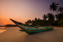 Fishing boat on the beach at sunset. Sri Lanka Stock Image