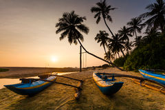 Fishing boat on the beach at sunset. Sri Lanka Royalty Free Stock Images