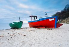 Fishing boat on the beach. Tranquil evening landscape. Royalty Free Stock Images