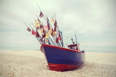 Fishing boat on beach, vintage retro filtered Royalty Free Stock Photography