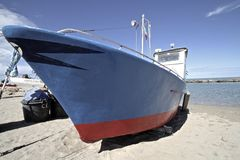 Fishing boat on beach Stock Photography