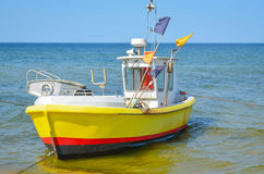 Fishing boat on beach Stock Photos
