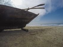 Fishing boat on the beach. Wooden fishing boat on the beach Stock Photos