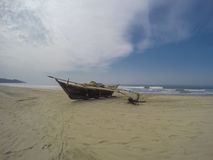 Fishing boat on the beach. Wooden fishing boat on the beach Royalty Free Stock Photo