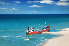 Fishing boat beached. Shipwreck in the sea stock image