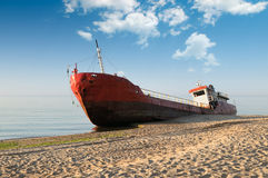 Fishing boat beached. And blue sky royalty free stock image