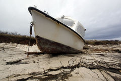 Fishing boat beached on a rock Stock Image