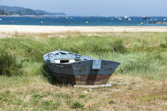 Fishing boat beached on the sand. Photo taken in Aldan, Cangas de Morrazo, Vigo estuary, Pontevedra, Spain stock image