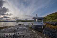 Fishing boat beached by slipway in Skye Royalty Free Stock Photo