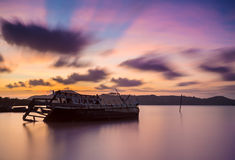 Fishing boat beached with sunset view. Thai Royalty Free Stock Photos