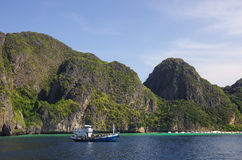 Fishing boat, beautiful limestone cliffs, clear sea and beach, P Royalty Free Stock Images