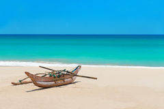 Fishing boat at beautiful ocean palm beach Royalty Free Stock Photos