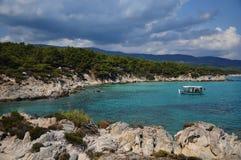 Fishing boat in the beautiful sea bay. Mediterranean Stock Photography