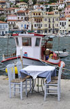 Fishing boat behind a smal table Stock Photos