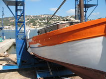 Fishing boat being painted. Red and white fishing boat being painted in Andratx, Mallorca, Spain Royalty Free Stock Photos