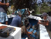 A fishing boat being repaired in the caribbean stock video footage