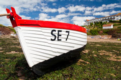 Fishing boat berth at low tide devon beach. In summer royalty free stock images