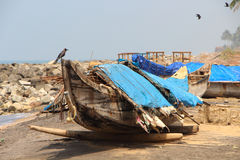 Fishing boat on a black beach. Varkala. India Stock Photo