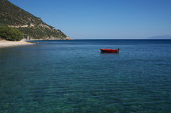 Fishing boat in blue ocean. Small red fishing boat in blue mediterranean ocean Royalty Free Stock Photography