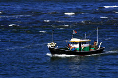 Fishing boat in blue sea Stock Photography