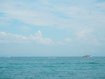Fishing boat in blue sea with clouds sky background in Thailand. Relaxing moments in summer seasons travel. Stock Images