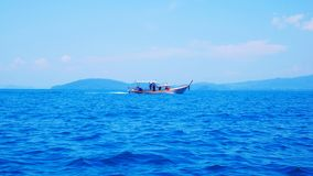 Fishing boat on the blue sea ,southern of Thailand ,Krabi province royalty free stock images