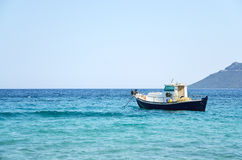 Fishing boat in blue waters Royalty Free Stock Images