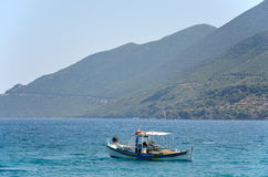 Fishing boat in blue waters Royalty Free Stock Photos